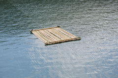 Bamboo raft floating on water. Surface, travel in natural Stock Images
