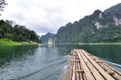 Bamboo raft heading on lake Stock Photo