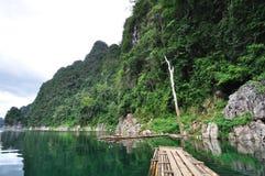 Bamboo raft heading on lake. In Kho Sok national park, Thailand Stock Photo
