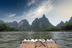 Bamboo raft and karst mountain landscape Stock Photography