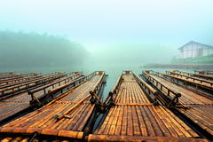 The bamboo raft lake. Early morning mist, the lake's quietly waiting for tourists on bamboo rafts Royalty Free Stock Images