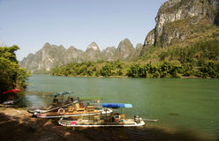 Bamboo raft with li river landscape Royalty Free Stock Photo