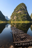 Bamboo raft at Li river with limestone hills Royalty Free Stock Photography