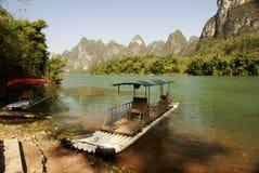 Bamboo raft with lijiang river Royalty Free Stock Image