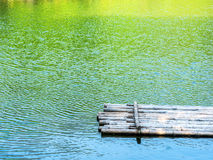 Bamboo raft in river with color reflection of tree,mountain and Stock Images