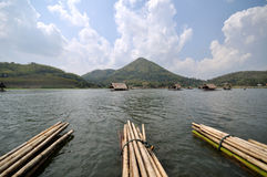 Bamboo raft. In the river (Huay-Krating) with blue sky and clould, Loei Province, Thailand Royalty Free Stock Photo