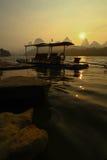 Bamboo Raft Sunrise. Chinese bamboo raft sunrise silhouette karst peaks Li River Yangshuo China Royalty Free Stock Photos