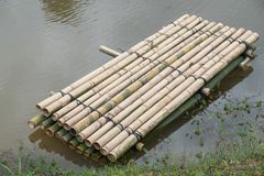 Bamboo raft. A way to travel by water. The human used since ancient times Royalty Free Stock Photography