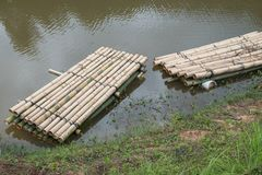 Bamboo raft. A way to travel by water. The human used since ancient times Royalty Free Stock Image