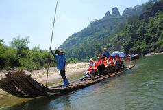 Bamboo raft on Wuyi river. The bamboo raft trip gives you an experience of nine bends and eighteen curves by fleeting through the Wuyi river Stock Image