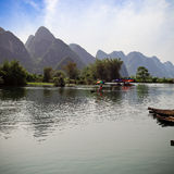 Bamboo raft on the yulong river Royalty Free Stock Photo