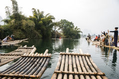 Bamboo rafting along Yulong River during the winter season with beauty of the landscape is a popular activity in Guilin. Royalty Free Stock Photography