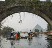 Bamboo rafting along Yulong River during the winter season with beauty of the landscape is a popular activity in Guilin. Stock Photo