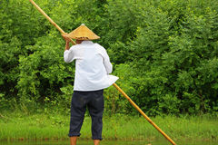 Bamboo rafting, China. Man rowing a bamboo raft in Yulong river, in Yangshuo, China Royalty Free Stock Photo