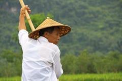 Bamboo rafting, China. Man rowing a bamboo raft in Yulong river, in Yangshuo, China Royalty Free Stock Image