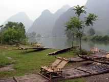 Bamboo rafting in China. Rafting down the river in china on a bamboo raft Royalty Free Stock Photos