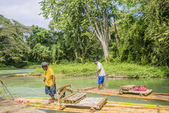 Bamboo Rafting on the Martha Brae River in Jamaica. MONTEGO BAY, JAMAICA - FEBRUARY  11, 2015: Bamboo Rafting on the Martha Brae River, a popular tourist Royalty Free Stock Photo