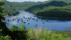 Bamboo rafting on Nam Man reservoir stock video footage