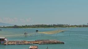 Bamboo Rafts Fishing Nets in Sea Bay in Vietnam stock video