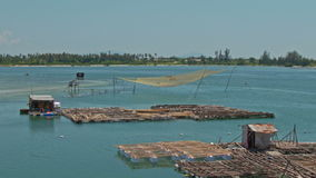 Bamboo Rafts Fishing Nets in Sea Bay in Vietnam stock video footage