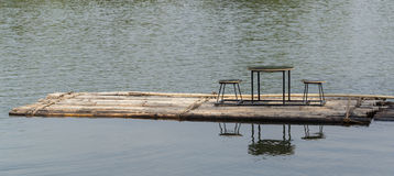 Bamboo rafts floating in river and dining table and chair Stock Photos