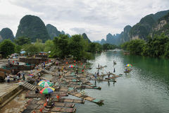 Bamboo rafts and karst mountains reflected in Yulong river Royalty Free Stock Image