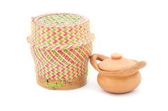 Bamboo rice box and samll clay pot. Thai style isolated on white background Stock Photos