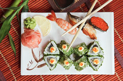 Bamboo rolls and sushi with a shrimp, eel. And caviar of flying fish Royalty Free Stock Images