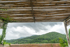 Bamboo roof and mountain Stock Photography