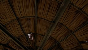 Bamboo Roof Symmetry. A bamboo roof and supporting beams provides a rustic symmetry Stock Photography