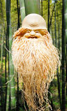 Bamboo root carving. Art, smile kind old man Royalty Free Stock Images