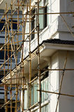 Bamboo scaffolding in construction site Stock Images