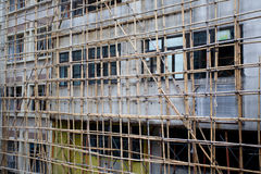 Bamboo scaffolding in front of the building. Royalty Free Stock Photo