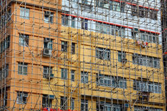 Bamboo scaffolding of old buildings Stock Photos