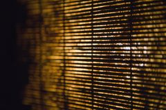 Bamboo shades. Bamboo shades with light showing through stock image