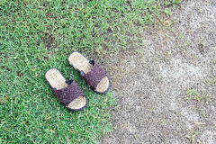 Bamboo shoes on grasses floor Stock Photography