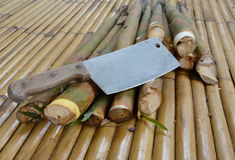 Bamboo shoot and chop knife on bamboo table Stock Photography
