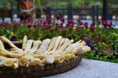 Bamboo shoots drying in basket next to flowers, Chinese cuisine, CHINA royalty free stock photo