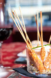 Bamboo skewer with fried king prawns Royalty Free Stock Photos