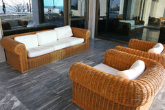 Bamboo sofa. Bamboo outdoors sofa with several white cushions Royalty Free Stock Photos