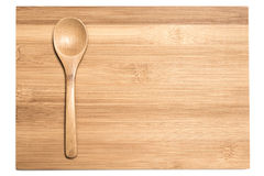 Bamboo spoon on the cutting board. Bamboo spoon and cutting board on the white background, emply space Royalty Free Stock Photography
