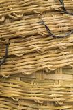 Bamboo stack basket weave texture. Background of stack of big bamboo basket weave texture Royalty Free Stock Photo