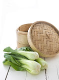 Bamboo steamer and bok choy royalty free stock photos