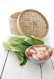 Bamboo steamer, bok choy and prawns royalty free stock images