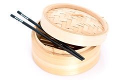 Bamboo steamer and chopsticks Royalty Free Stock Image
