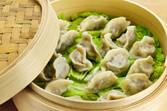 Bamboo steamer with dumplings Royalty Free Stock Images