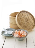 Bamboo steamer and prawns. Asian cuisine bamboo steamer and prawns royalty free stock photography
