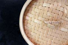 Bamboo Steamer Top View. Chinese style bamboo steamer top view against dark background royalty free stock images