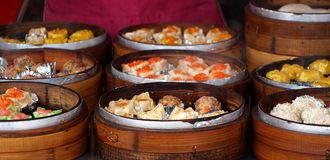 Bamboo Steamers with Dim Sum Dishes Stock Photo