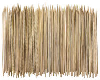Bamboo sticks for a barbecue. Sharp round yellow bamboo sticks for a barbecue big border. Isolated on white Royalty Free Stock Photo